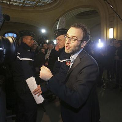 Fabrice Epstein, foreground, the lawyer of Pascal Simbikangwa, addresses reporters at his arrival at court (AP Photo/Remy de la Mauviniere)