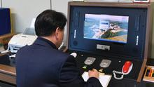 A South Korean government official checks the direct communications hotline to the North Korean side (Yonhap/AP)