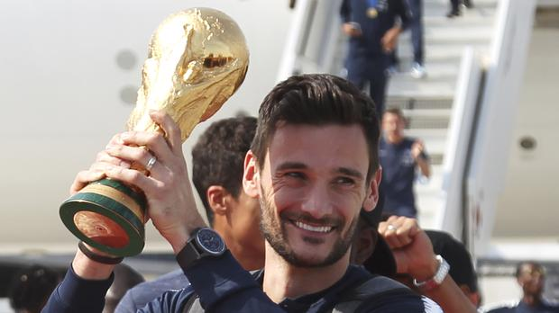 French goalkeeper and captain Hugo Lloris holds the cup (AP)