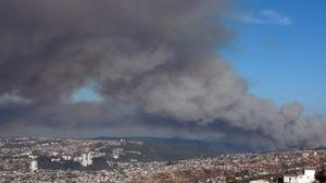 Plumes of smoke from a wild fire rise over Valparaiso, Chile (AP)