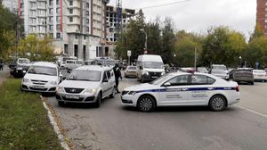 Police block the road near the scene after a gunman opened fire at the Perm State University in Perm, Russia. Photo: REUTERS/Anna Vikhareva.