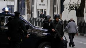 Security forces deployed in front of the British embassy in Cairo, Egypt earlier in December (AP)