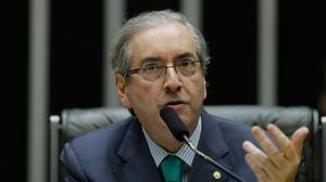Eduardo Cunha, president of Brazil's chamber of deputies, speaks during a congressional session as the supreme court approved further investigations into a massive kickback scheme at state-run Petrobas (AP)