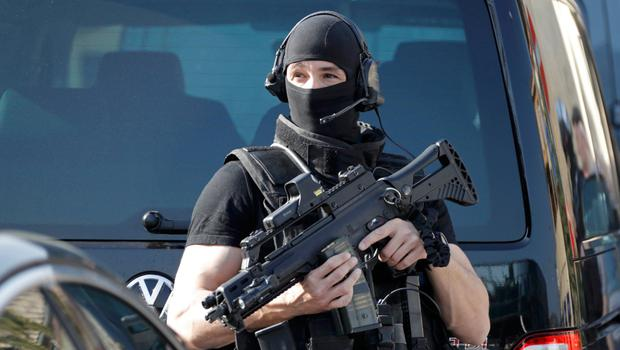 A member of special police unit RAID outside the Tocqueville secondary school. Photo: Reuters/Eric Gaillard.