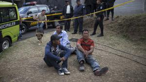 Relatives wait outside the children's shelter in Guatemala (AP/Luis Soto)