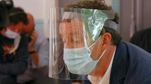 A man wearing a face mask and visor to protect against coronavirus during voting in the second round of the municipal elections in France (Michel Spingler/AP)