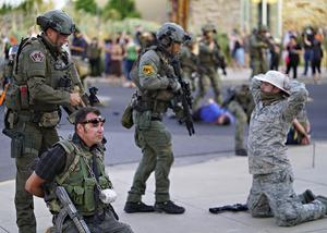 Albuquerque police detain members of the New Mexico Civil Guard, an armed civilian group, following the shooting of a man during a protest over the statue (Adolphe Pierre-Louis/The Albuquerque Journal via AP)