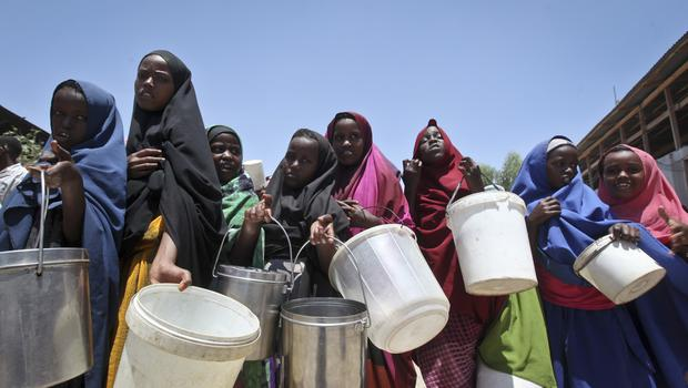 Somali girls who fled the drought queue to receive food handouts in Mogadishu (Farah Abdi Warsameh/AP)
