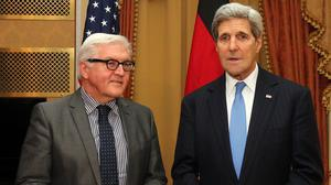 German foreign minister Frank-Walter Steinmeier and US Secretary of State John Kerry meet during nuclear talks with Iran in Vienna (AP)
