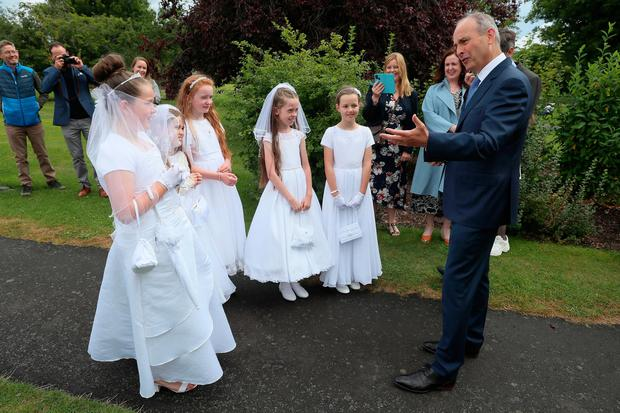 Taoiseach Micheal Martin meets pupils from St. Brigid's Girls National School in Glasnevin - Isabella Ryan (10), Ella Brereton (9), Charlotte Collins (9), Caoimhe Flanagan (10), and Faye Haverty (10) - who made their communion Photo: Brian Lawless/PA