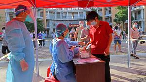 Residents register to take nucleic acid tests at a testing site in Quanzhou, China, following new cases of Covid-19. Reuters
