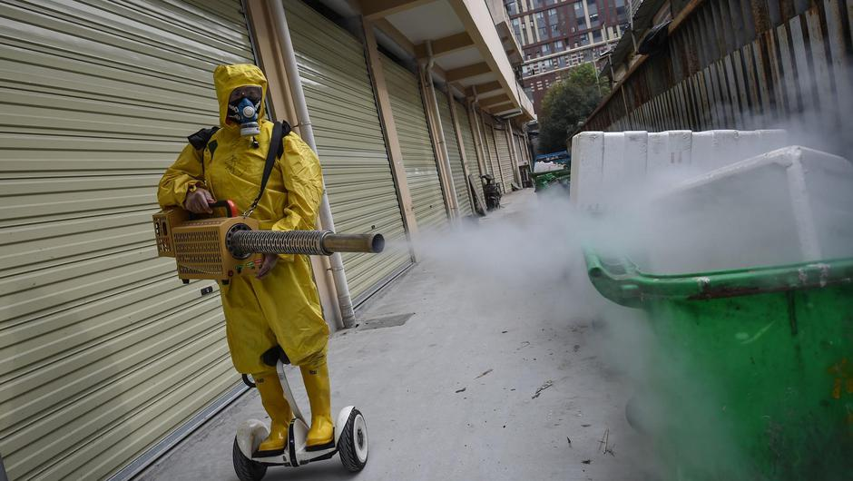 Disinfectant is sprayed in Wuhanlast March during the early days of the Covid outbreak. A laboratory in the city had been researching closely related viruses before the pandemic...I