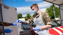Members of the military carry out coronavirus tests at the Edgbaston Cricket Ground Covid-19 testing site in Birmingham (Jacob King/PA)