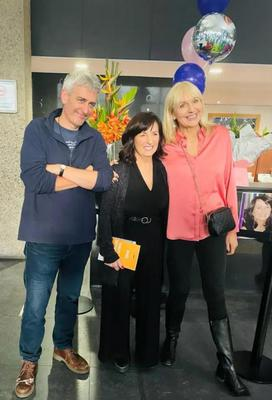 Staff member Phil Collins with presenters David McCullagh and Miriam O'Callaghan