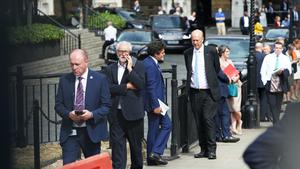 MPs were reminded to observe social distancing measures as they queued before walking through the Commons chamber (Jonathan Brady/PA)