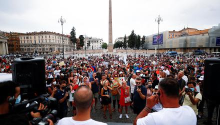 Protesters demonstrate against Covid pass plan in Rome. Photo: Guglielmo Mangiapane/Reuters