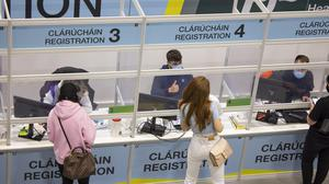 Young people register for a vaccine at the walk-in centre in CityWest, Dublin, earlier this year. Photo: Fergal Phillips