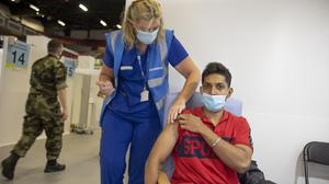 Mithun Haizel receives hisinoculation against Covid-19by nurse Joan O'Halloran at CityWest, Dublin. Picture by Fergal Phillips.