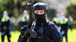 Riot Police respond as protesters rally against mandatory Covid vaccines for the construction industry in Melbourne, Australia. Reuters