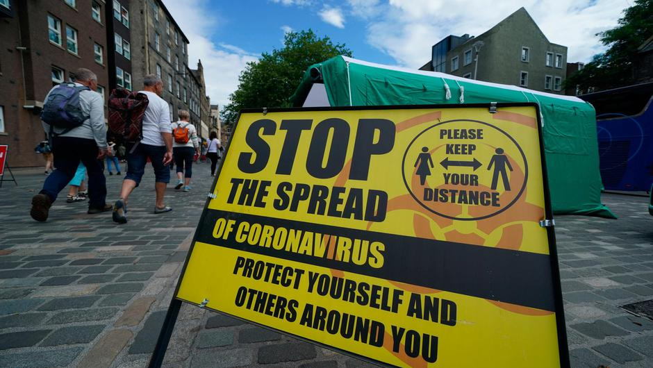 A Covid-19 information sign in Edinburgh. Photo: Andrew Milligan/PA Wire