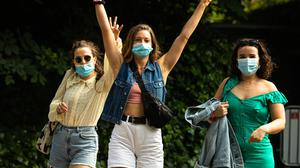 Masked concert-goers at Ireland's first live gig since the Covid-19 pandemic at the Iveagh Gardens, Dublin. Vaccinations will begin in younger people in the next few weeks. Photo: Mark Condren