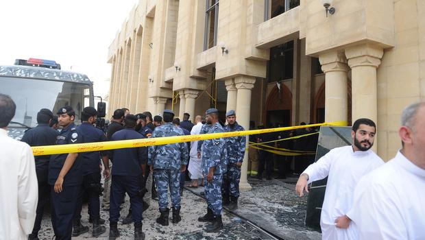 Security forces and officials gather at a Shiite mosque after a deadly blast that struck worshippers attending Friday prayers in Kuwait City (AP)