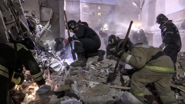 Emergency workers sifted through the rubble (AP)