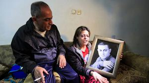Mohamed Said Ismail's mother holds a picture of her son. (AP Photo/Mahmoud Illean)