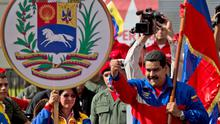 President Nicolas Maduro blamed 'gringo' interference for slapping diplomatic and travel curbs on the US (AP)
