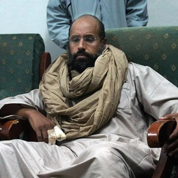 Seif al-Islam has appeared in court on charges of harming state security (AP)