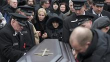 Boris Nemtsov's mother Dina Eidman, centre, relatives and friends during a burial ceremony at Troekurovskoye cemetery in Moscow (AP)