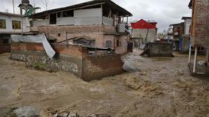 Houses are partially submerged in flood waters in Srinagar, Indian-controlled Kashmir (AP)