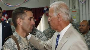 Beau Biden and his father Joe Biden, pictured in 2009 at Camp Victory on the outskirts of Baghdad (AP)