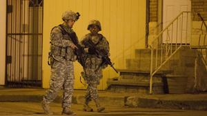 Members of the National Guard enforce a curfew in Baltimore (AP)
