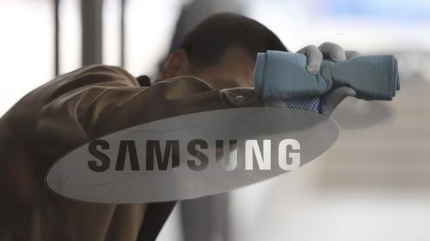 Samsung Electronics won praise for big share price gains, but criticism over its involvement in South Korea's political scandal (AP)