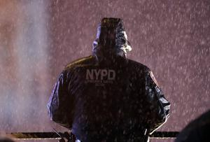 A member of the New York Police Department watches over revelers( Frank Franklin II/AP)