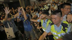 Protesters clashed with police officers at the end of a week-long strike by students in Hong Kong (AP)