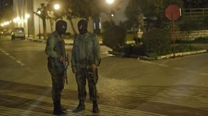 Masked Tunisian soldiers stand guard outside the National Bardo Museum (AP)