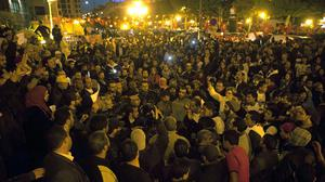 Tunisians gather at Habib Bourguiba avenue to show solidarity with the victims of the Tunis museum attack (AP)