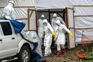 Members of the Ebola body management team remove dead bodies from a make shift morgue at Kenema General Hospital in Sierra Leone. Photo: Mark Condren