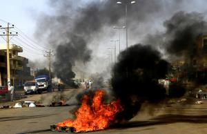 A burning barricade at the site of the sit-in in Khartoum. Photo: Reuters