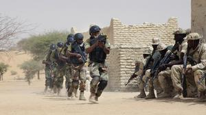 Nigerian special forces run past Chadian troops in a hostage rescue exercise at the end of the Flintlock exercise in Mao, Chad (AP)