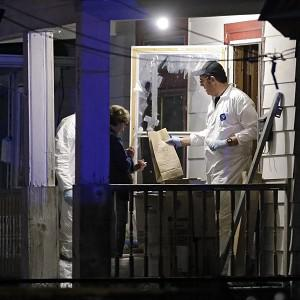 Members of the FBI evidence team remove items from a house in Cleveland after three women who went missing were found (AP)