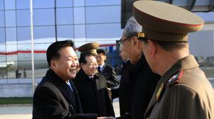 North Korean leader Kim Jong Un's special envoy Choe Ryong Hae, left, leaves the Pyongyang Airport for Russia (AP)