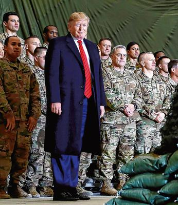 Commander in chief: US President Donald Trump visits Bagram Air Base, Afghanistan, late last year. Photo: Reuters