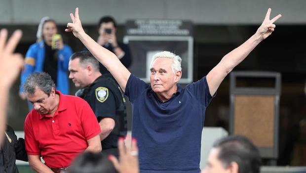 Roger Stone aping the Richard Nixon victory sign