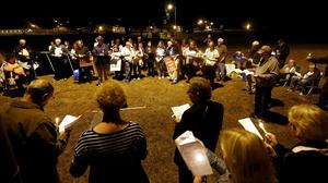 Death penalty opponents stand outside Florida State Prison, holding candles and singing songs during the execution of Chadwick Banks. Banks confessed to the murder of his wife, Cassandra Banks and her daughter Melody Cooper in 1992. (AP/Matt Stamey/The Gainesville Sun)