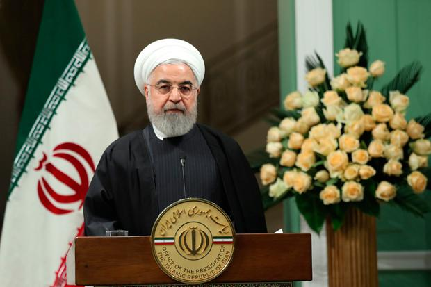 Rivals: Hassan Rouhani's supporters vented ire at the military. Photo: AFP via Getty