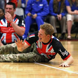 Prince Harry plays sitting volleyball with the United Kingdom team at the Warrior Games (AP/Rick Wilking)