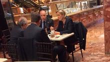 Far-right French presidential candidate Marine Le Pen has coffee with three men, including her partner Louis Aliot, second from right, at Donald Trump's New York headquarters. Photo: AFP/Getty Images